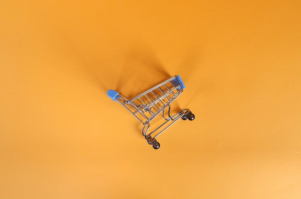 Shopping cart on orange background