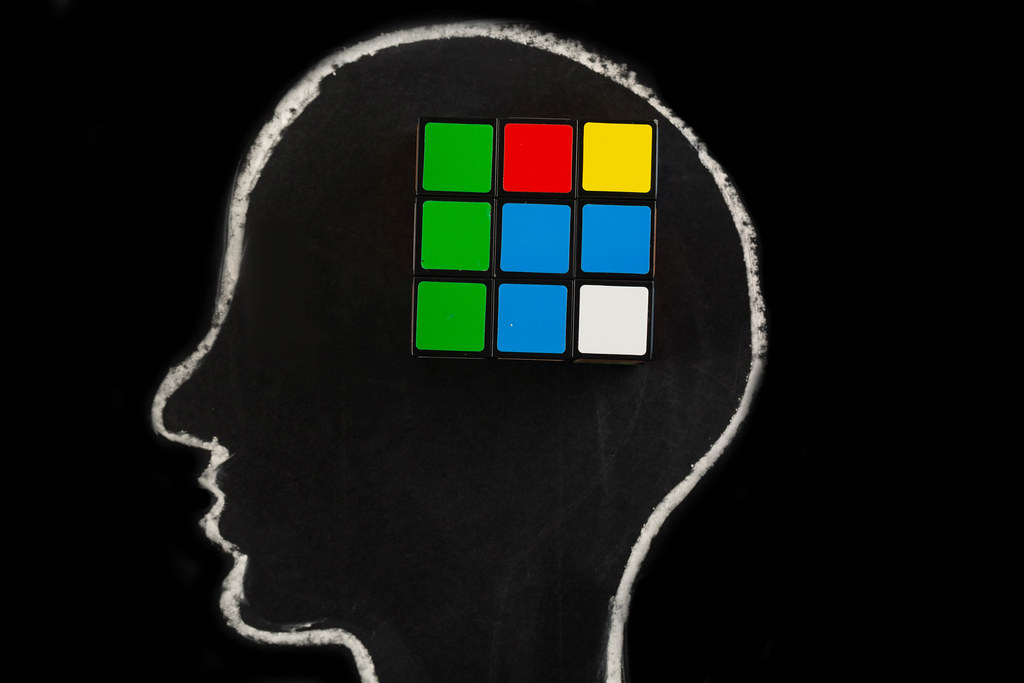 Silhouette of human head with rubik
