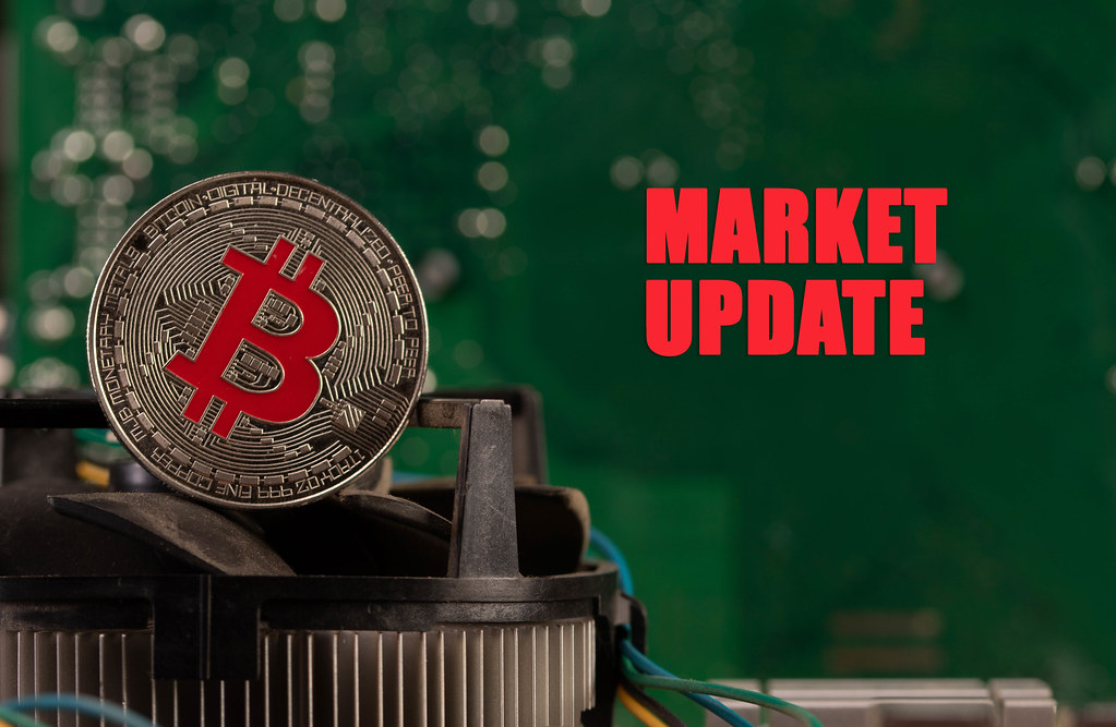 Silver Bitcoin on computer parts with Market Update text