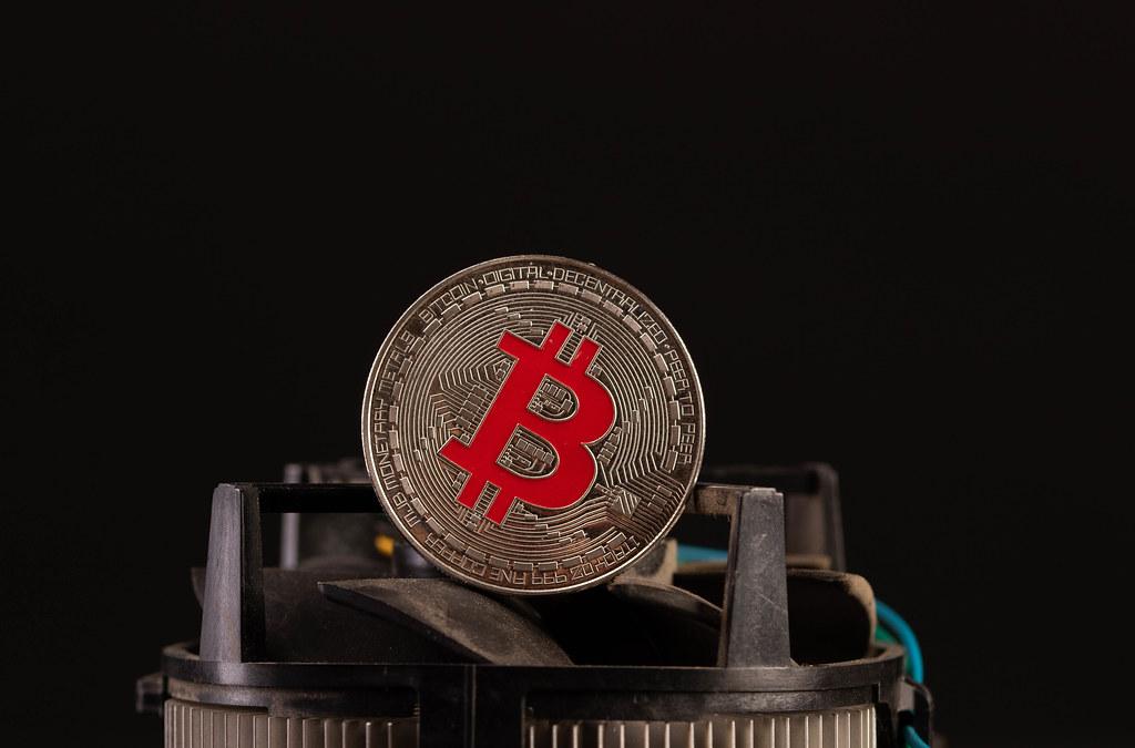 Silver Bitcoin on computer parts