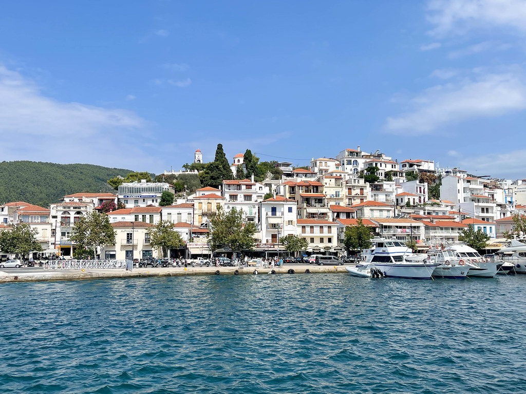 Skiathos town with houses on the sea promenade seen from the sea near the port of the Greek island