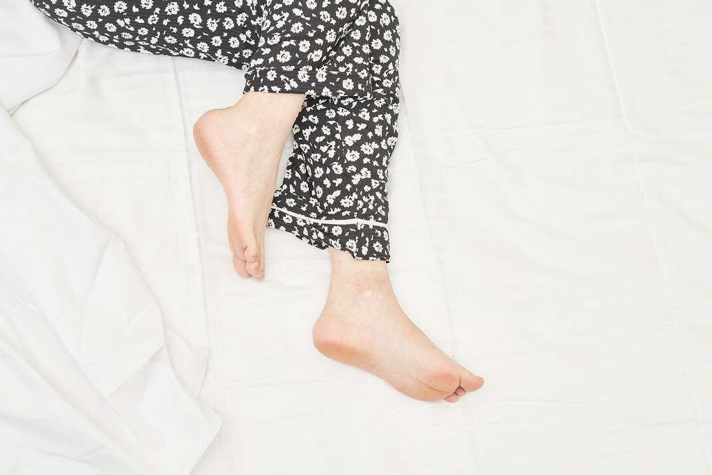 Sleeping female beautiful feet on the bed