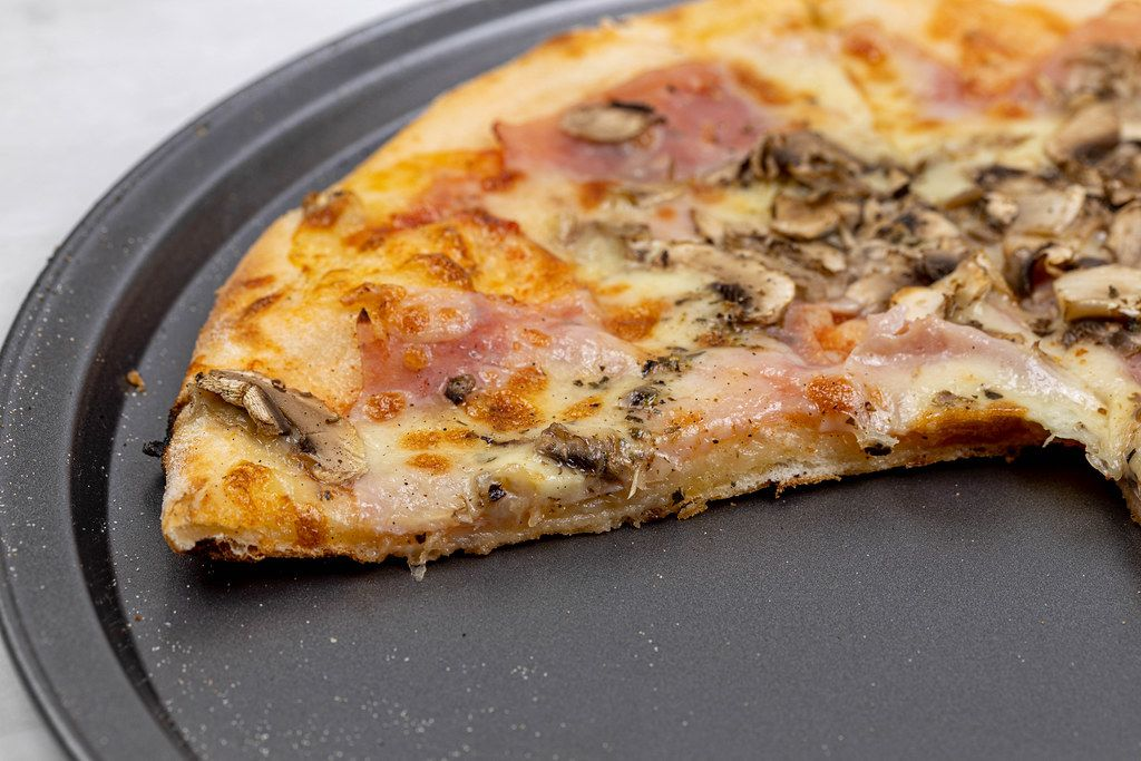 Slice of Pizza with Ham and Mushrooms