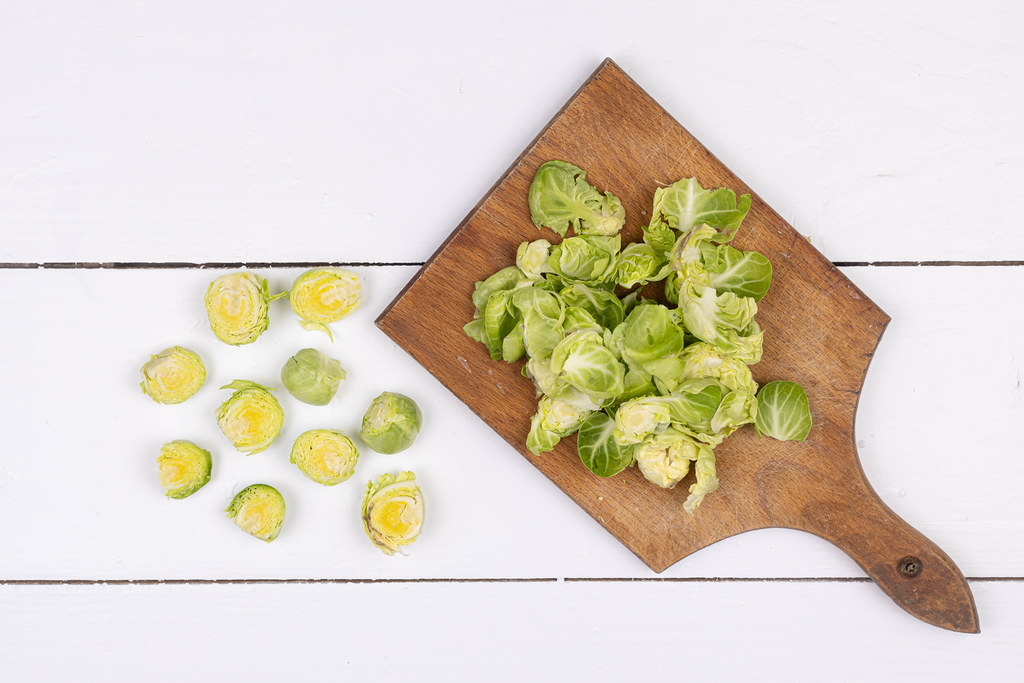 Sliced Brussel Sprouts on the wooden cutting board