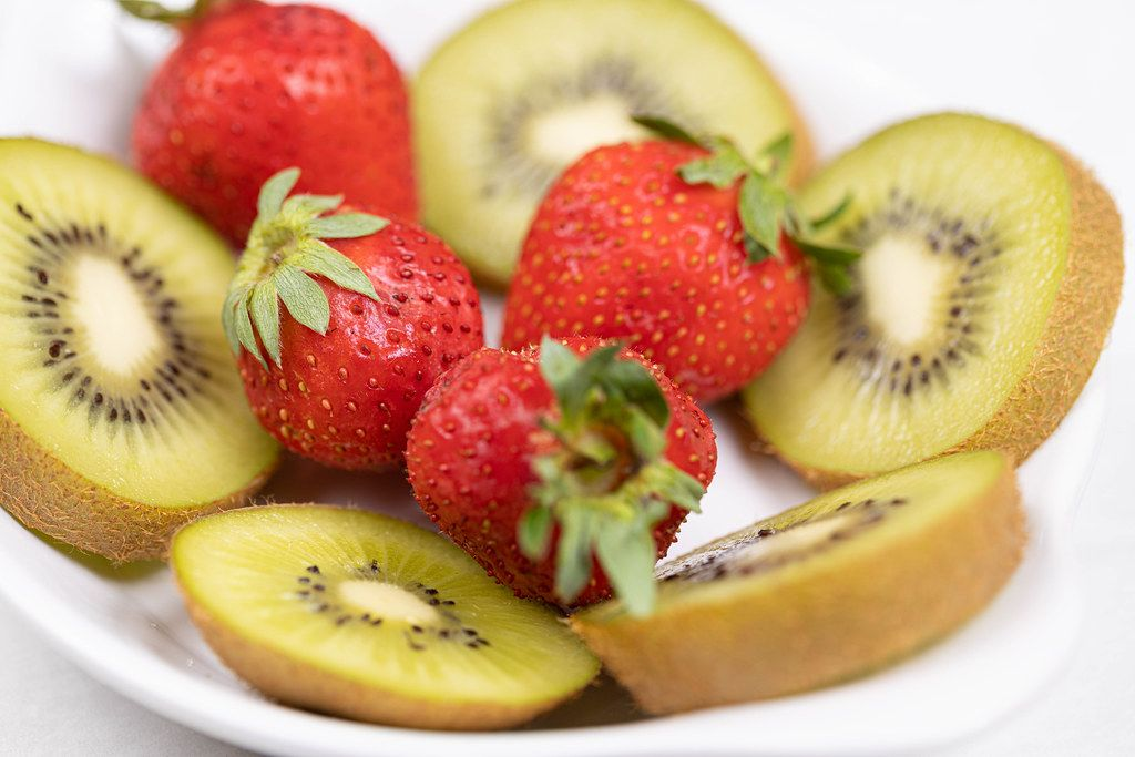 Sliced Kiwi and Strawberries served on the plate
