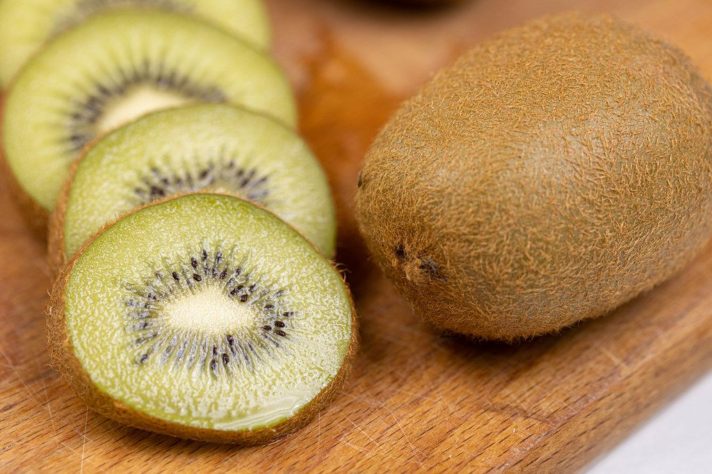 Sliced Kiwi on the wooden cutting board