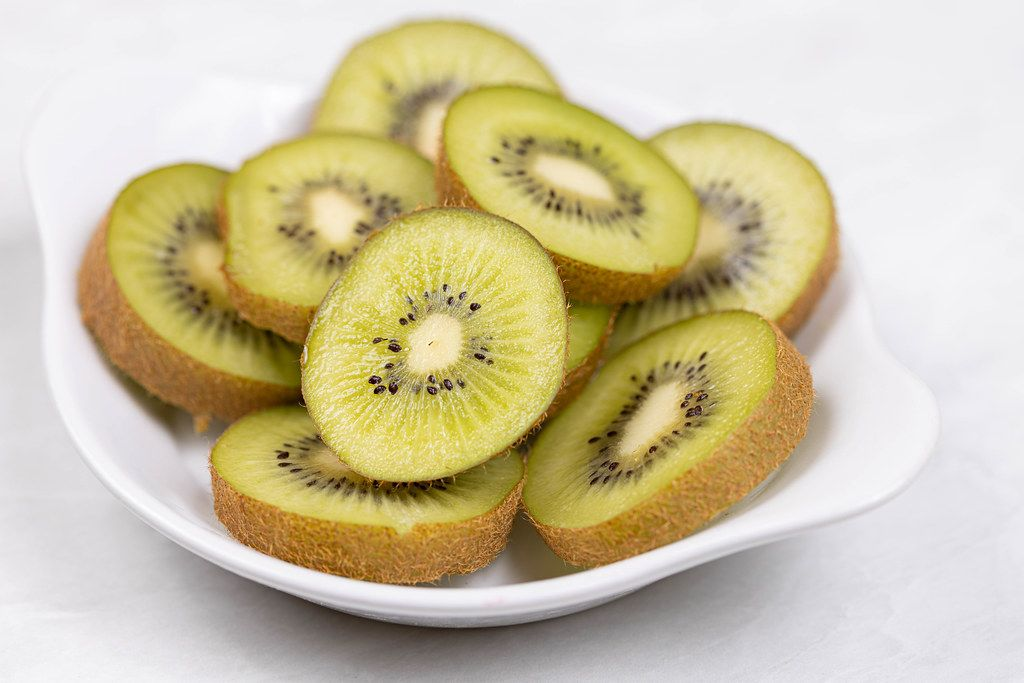 Sliced Kiwi served on the white plate