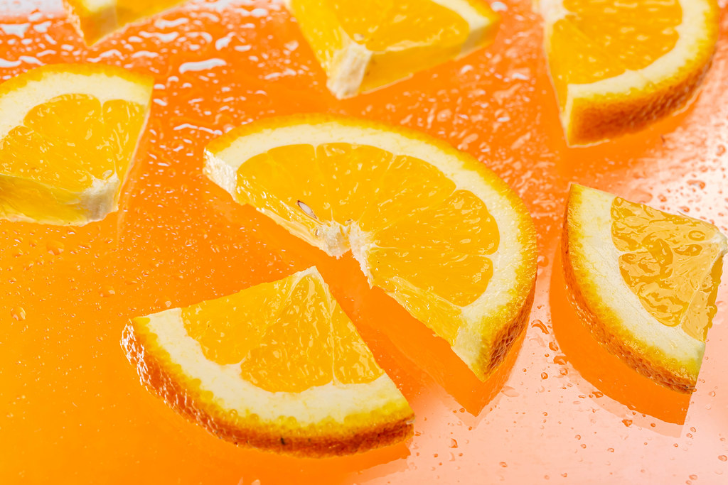Sliced pieces of fresh orange with water drops