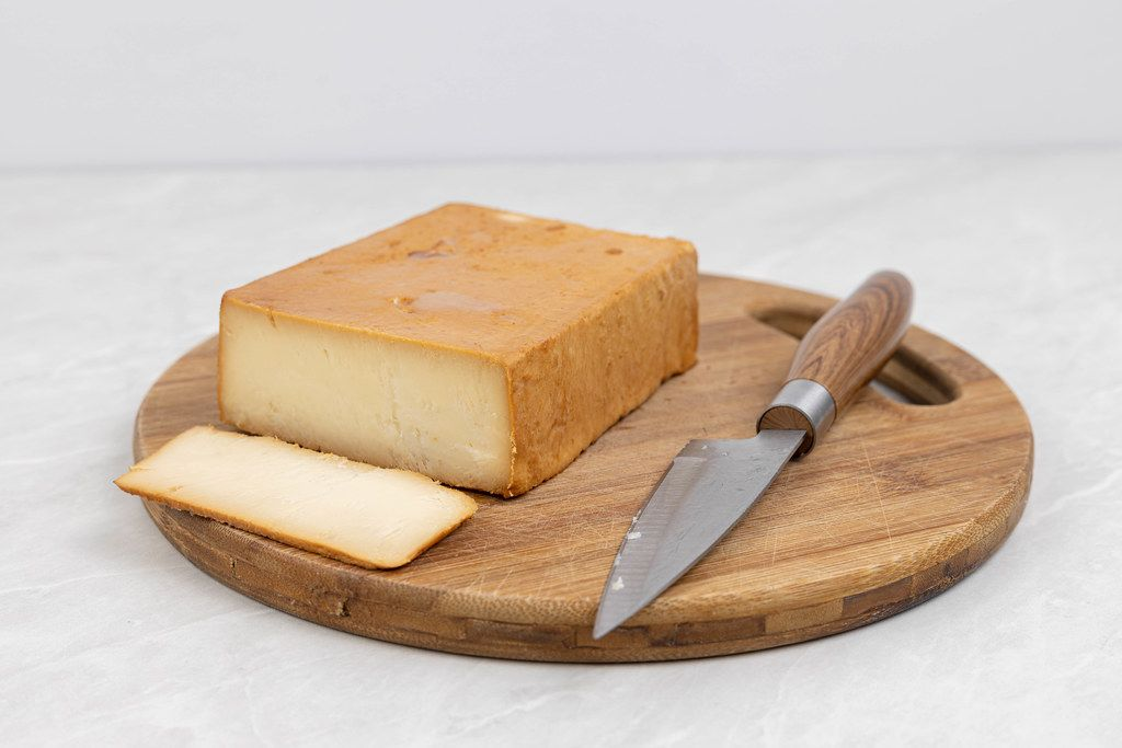 Sliced Smoked Cheese on the wooden board