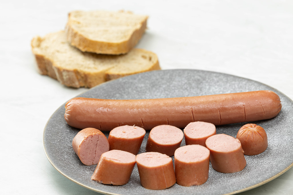 Sliced Wienerwurst on the plate with Bread