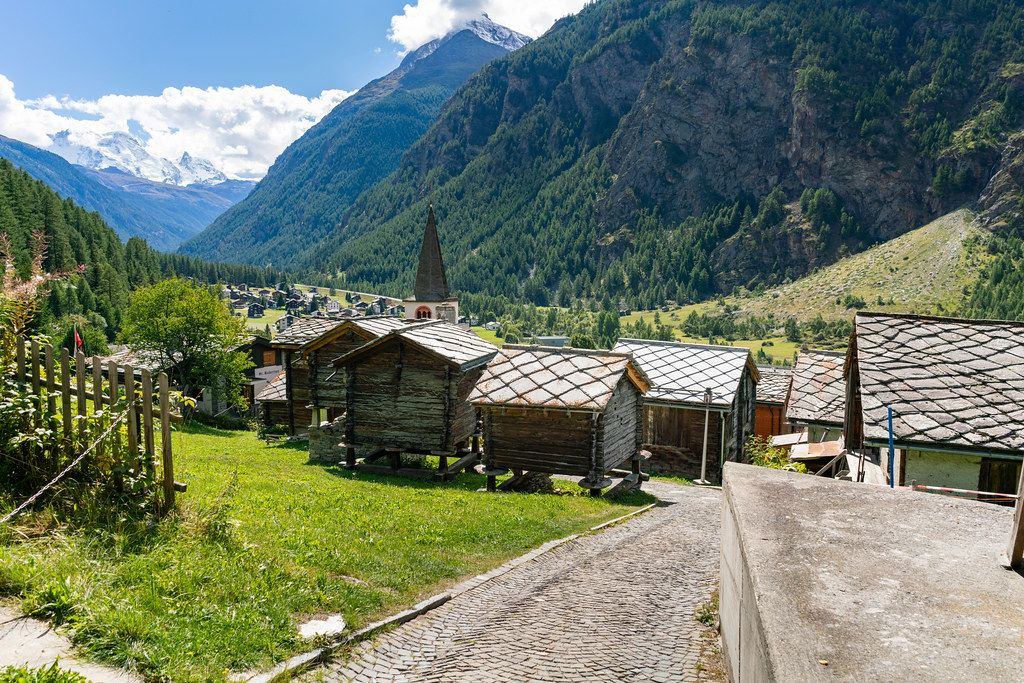 Small authentic Swiss wooden sheds on pillars in a valley village