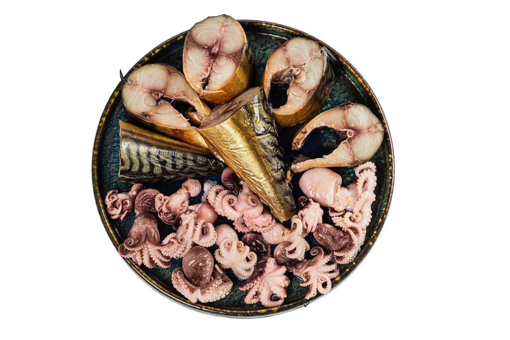 Smoked mackerel slices and octopus, top view