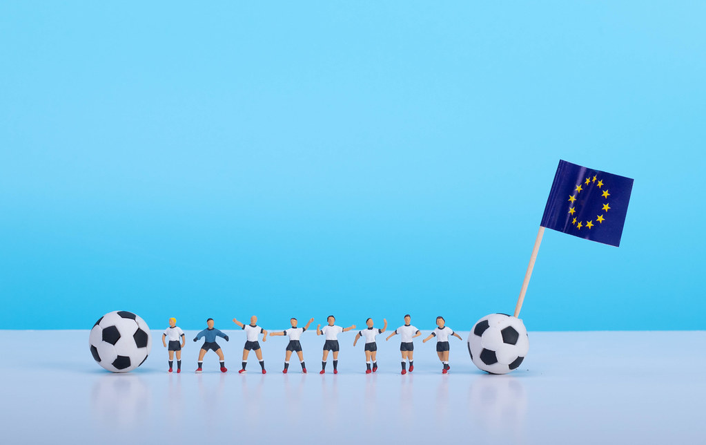 Soccer players with flag of European Union
