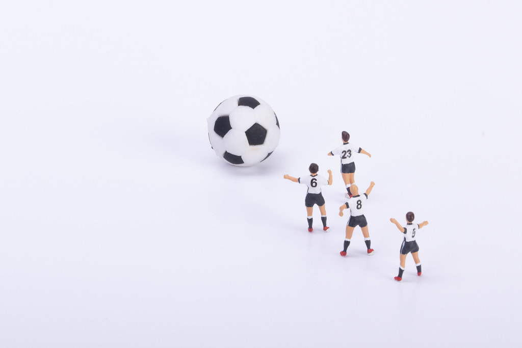 Soccer players with soccer ball on white