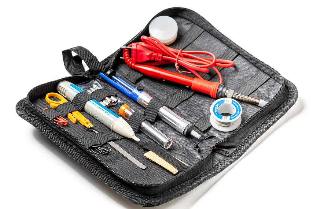 Soldering tool set in black case
