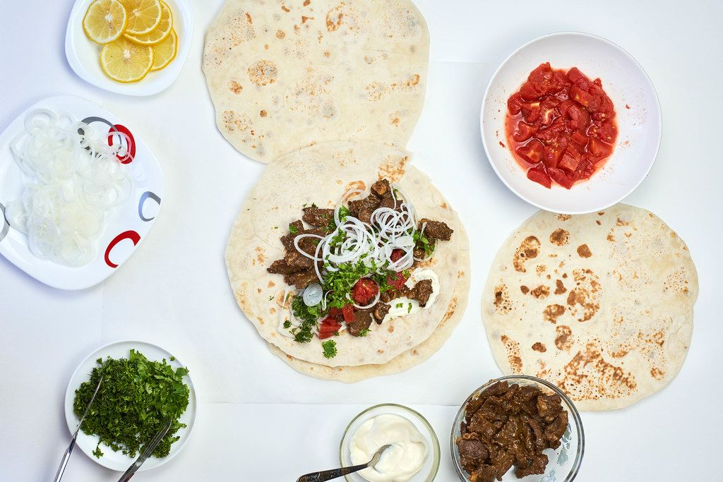 South Caucasus cuisine. Overhead view of Lavash flat bread with tasty ingredients to fill