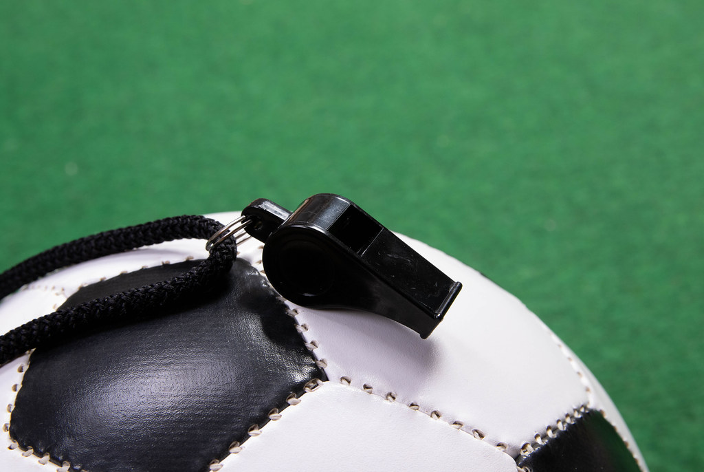Sports whistle on a soccer ball