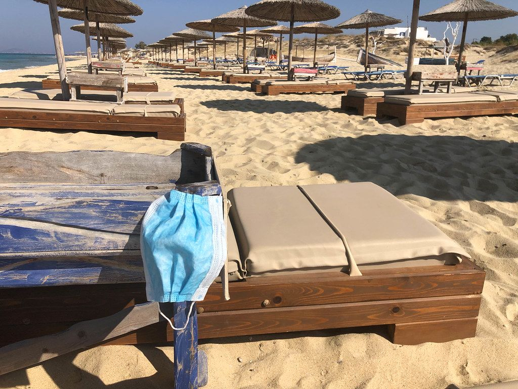 Staying safe and healthy during Corona vacation: face mask on a beach chair at Maragkas beach in Naxos, Greece