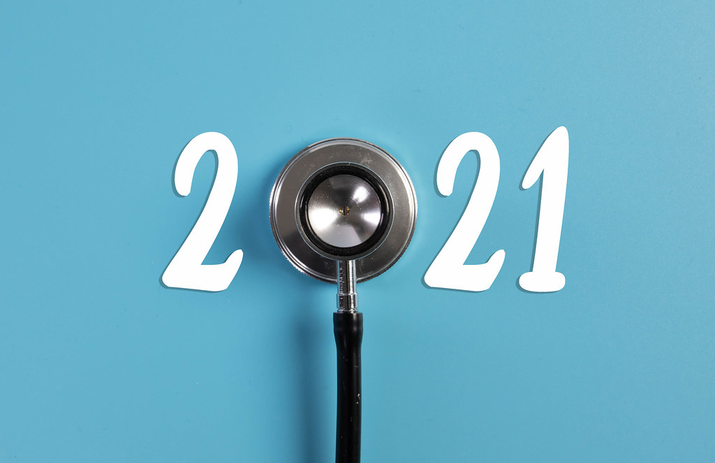 Stethoscope and 2021 text on blue background