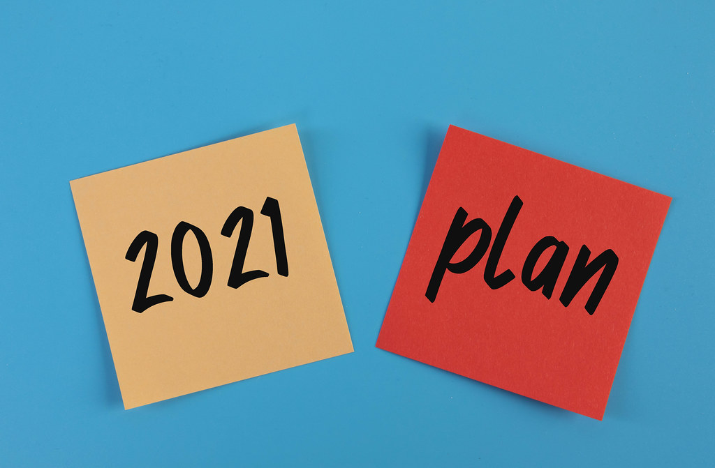 Sticky notes with 2021 Plan text on blue background