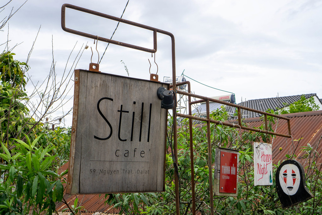 Still Cafe Entrance Board with other Brands on Wooden Boards in Da Lat, Vietnam