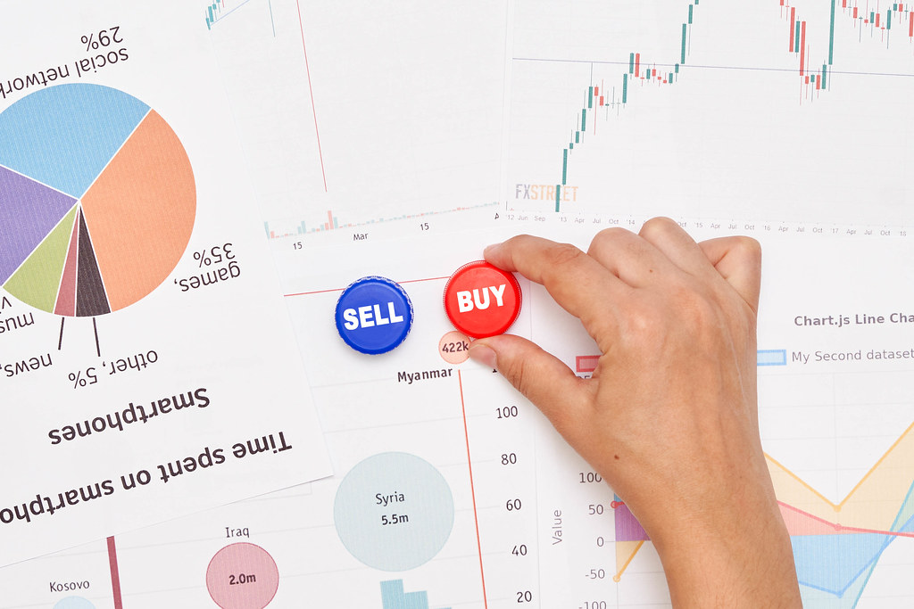 Stock market trader at work - buying and selling stocks