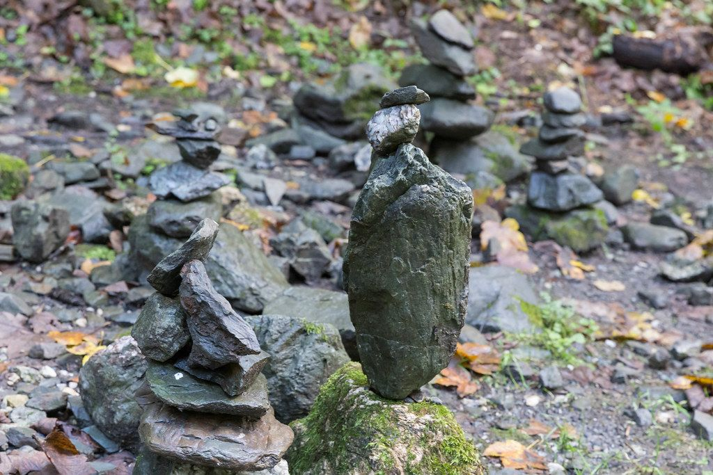 Stone figures as symbol of the group spirit, created by the Alpbach secondary school and complemented by hikers