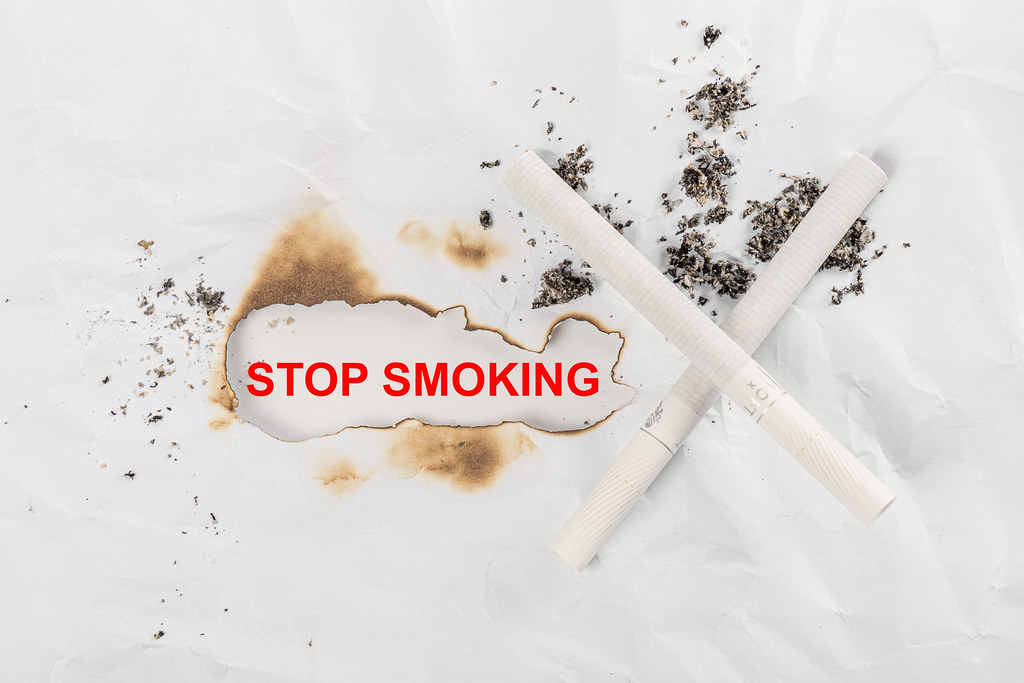Stop smoking background with cigarettes and ash