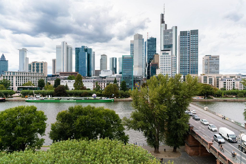 Straight on panorama of Frankfurt downtown with different skyscrapers from a viewpoint across the bridge