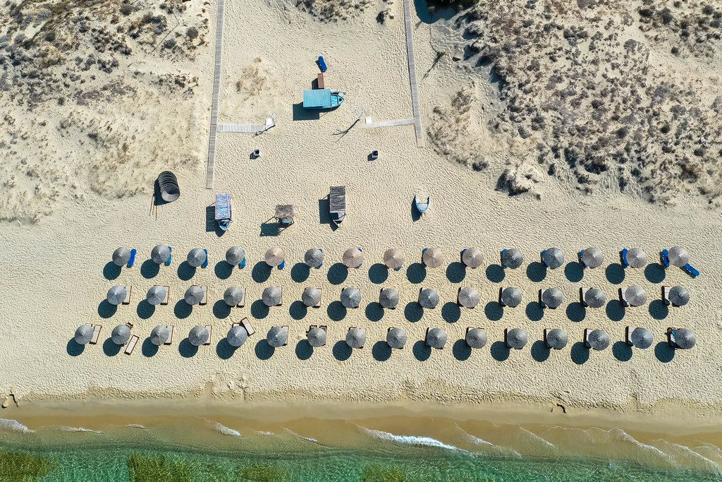 Summer 2020, holiday on the empty beach of Plaka with no tourists. Aerial view of Greek island of Naxos