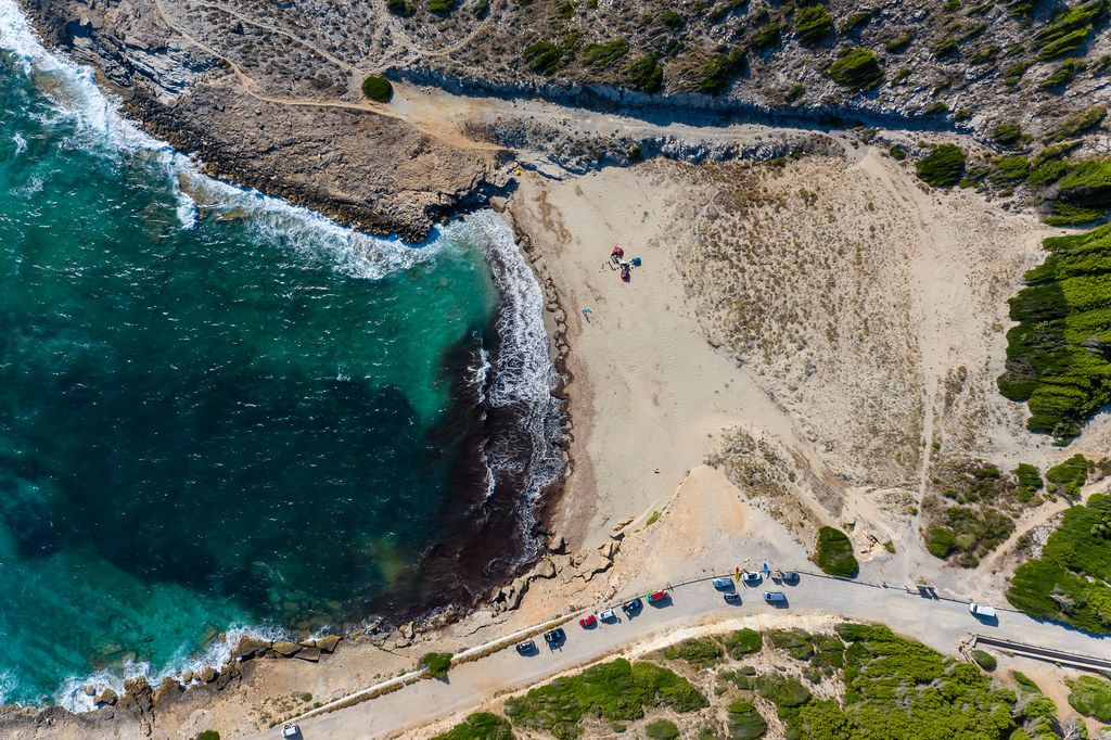 Summer 2020 in Majorca with almost empty, wild beaches: Cala Mitjana, overhead drone photo