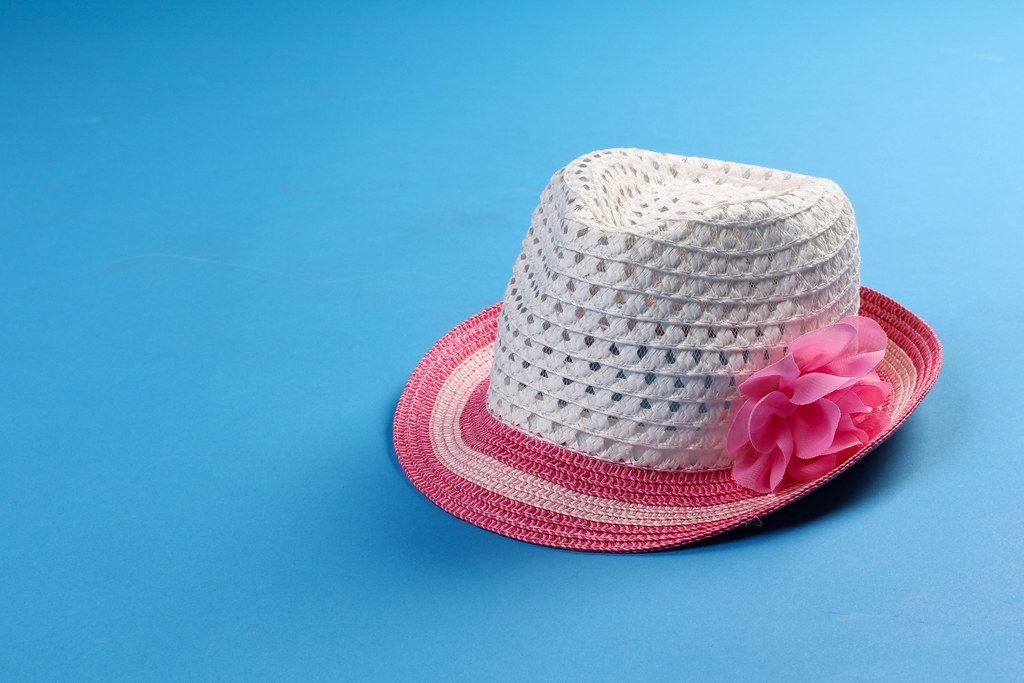 Summer beach hat on blue background