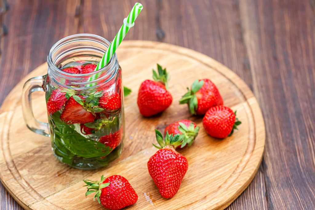 Summer strawberry drink with fresh mint leaves in a jar