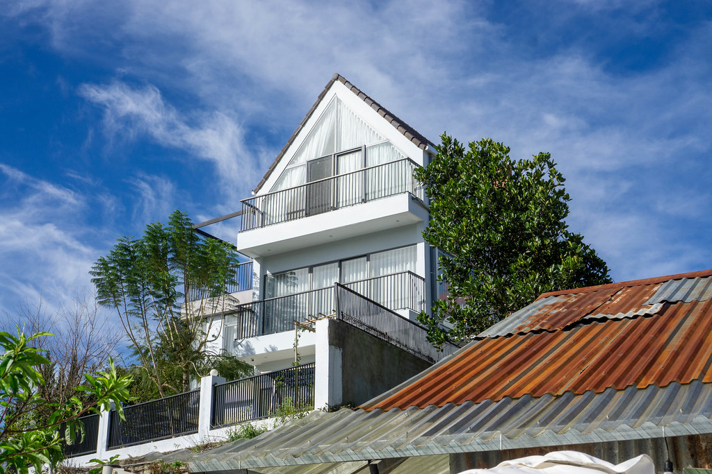 Sun Shining in a Modern House with Large Windows, Balconies and Terrace in the Mountains in Da Lat, Vietnam