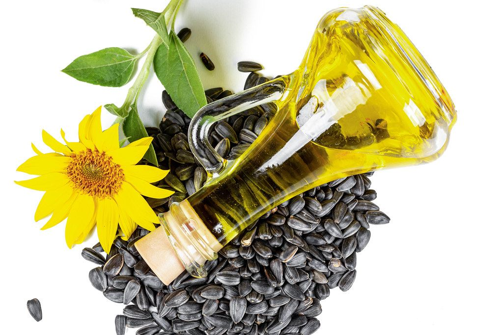 Sunflower oil and sunflower seeds, top view
