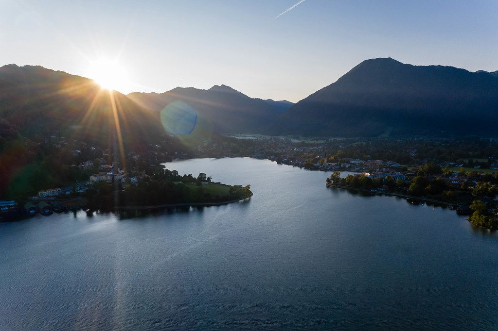 Sunset above Lake Tegernsee in Bavaria with alpine mountains in the background
