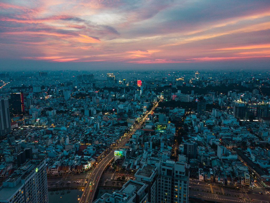 Sunset Drone Photo of Streets and Buildings with Lights from District 4 in Ho Chi Minh City, Vietnam