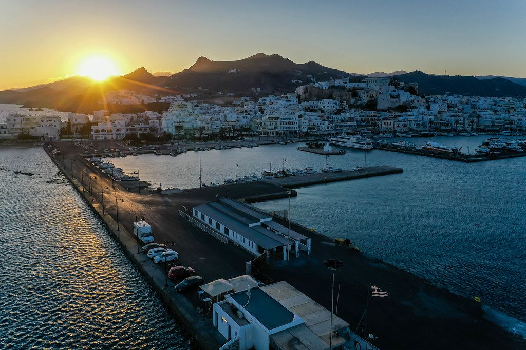Sunset over the port and main town of Naxos, Chora. Drone photo