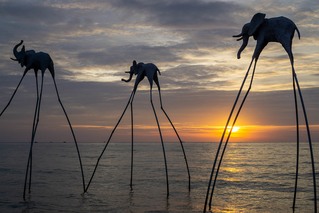 Sunset Photoshoot Motive of Flying Elephants in the Sea at Sunset Sanato Beach Club on Phu Quoc Island, Vietnam