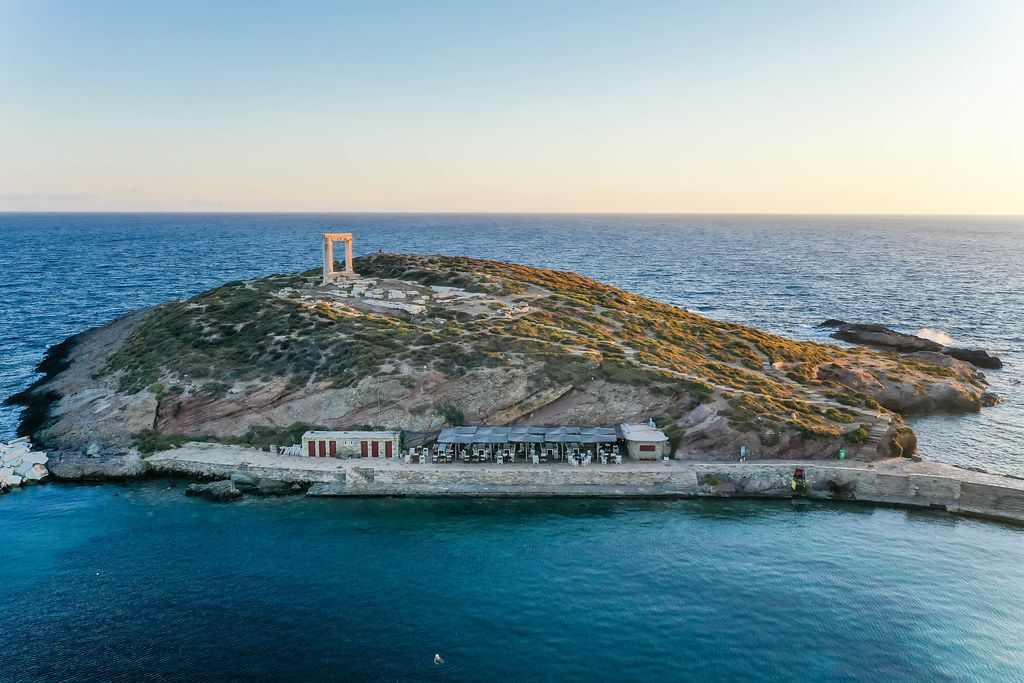 Sunset shot with a drone. The ruins of the Apollo temple, known as Portara. Main landmark of Naxos