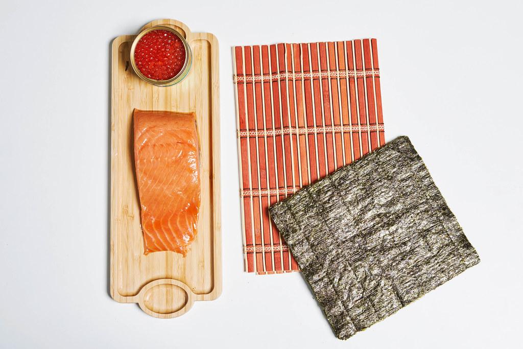 Sushi ingredients on white surface