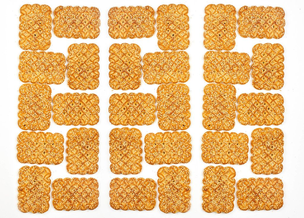 Sweet cookies puzzle on white