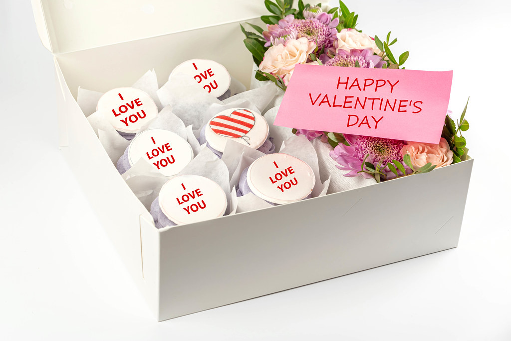 Sweet cupcakes with flowers in box, valentine's day concept