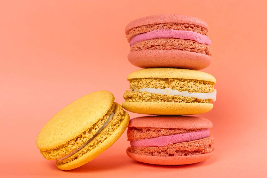 Sweet raspberry and lemon cookies on pink background