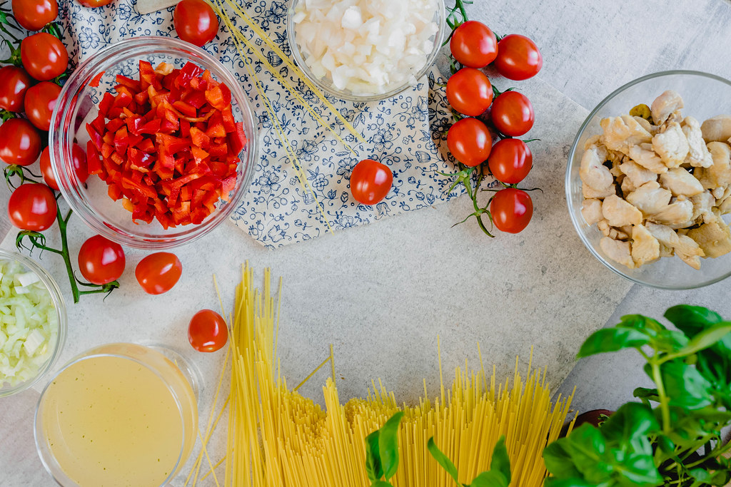 Table Flatlay Set With Chicken Spagetti Ingredients CloseUp