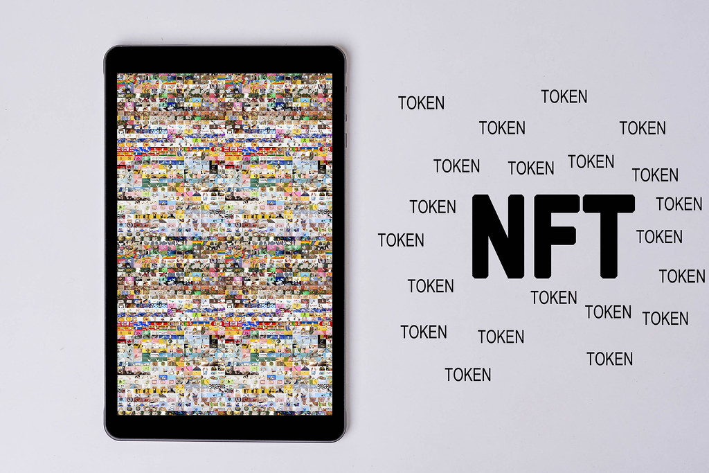 Tablet screen with a NFT art collage made of thousands of photos