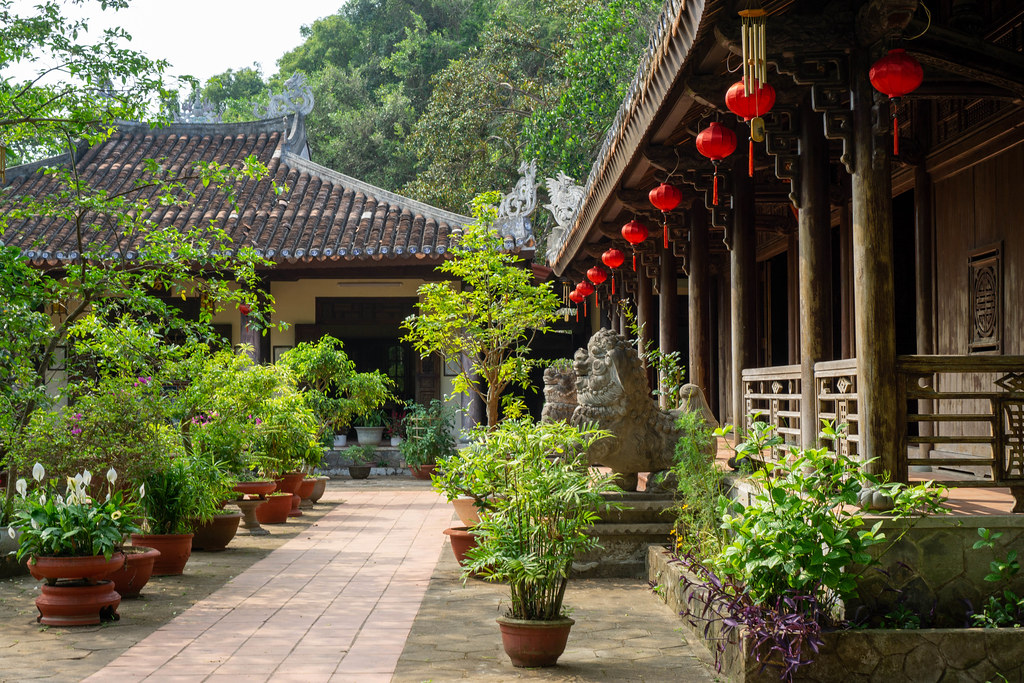 Tam Ton Pagoda with many Trees and Plants in Plant Pots, Red Lanterns and Statues of Chinese Guardian Lions at Marble Mountains in Danang, Vietnam