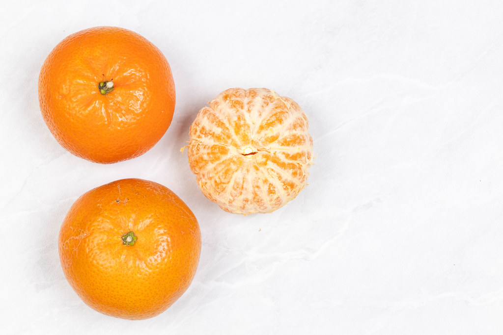 Tangerines on the grey marble table with copy space