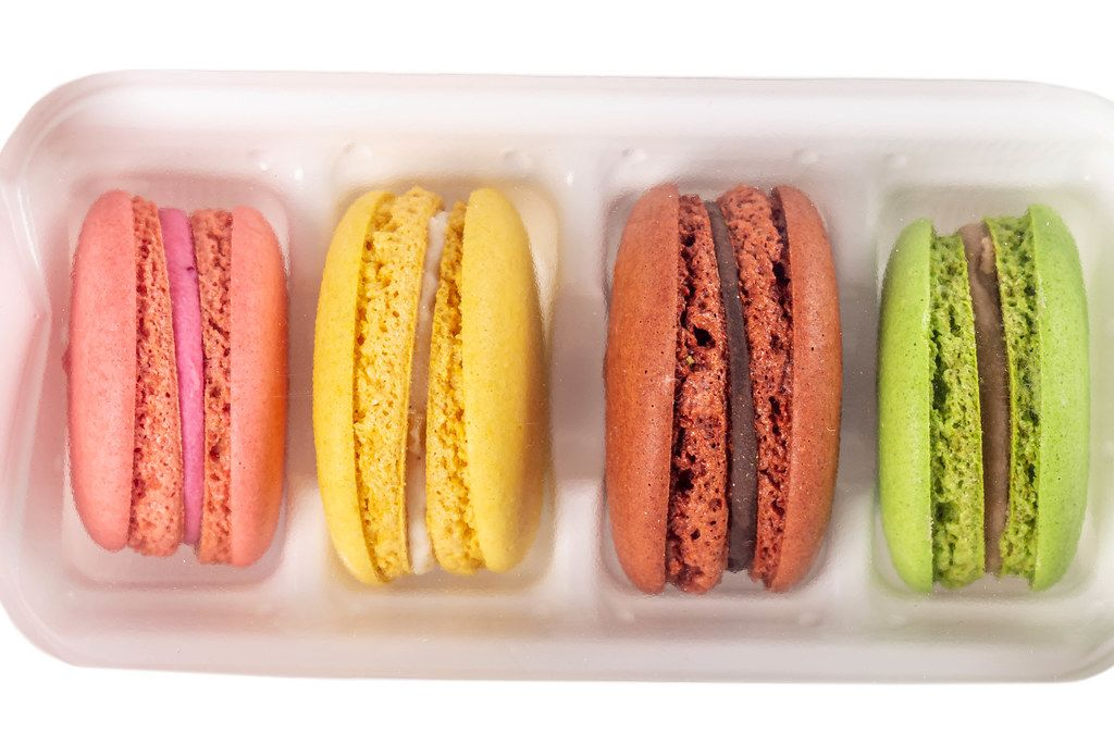 Tasty colorful macaroons in white box
