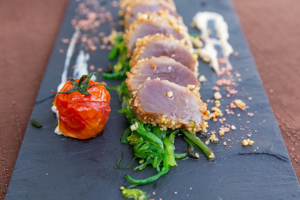 Tataki cooking: red tuna seared outside but raw inside. Served in almond crust at Q11 in Pollença